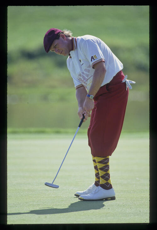 Payne Stewart watching his ball closely after a putt during the 1993 TPC