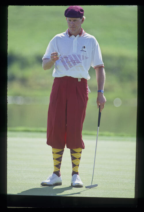 Payne Stewart examining his ball on the green during the 1993 TPC