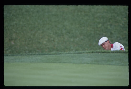 Payne Stewart examining his options in a bunker during the 1993 TPC