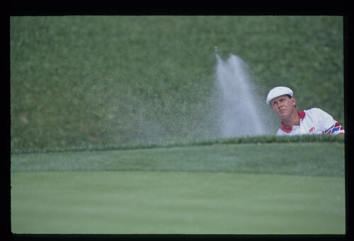 Payne Stewart splashing from a bunker during the 1993 TPC