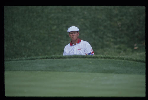 Payne Stewart considering his options in a bunker during the 1993 TPC