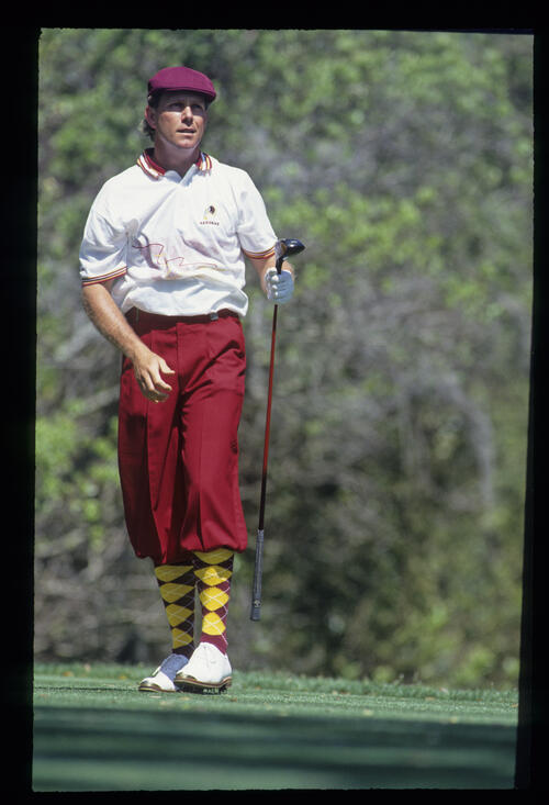 Payne Stewart watching closely after a drive during the 1993 TPC