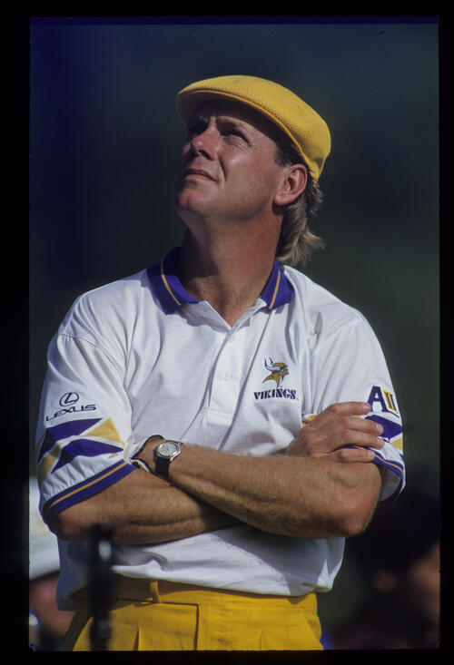 A pensive Payne Stewart with arms folded, looks to the sky during the 1993 Masters