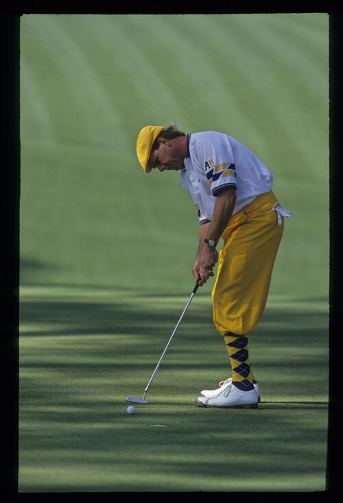 Payne Stewart sending a breaking putt on its way during the 1993 Masters