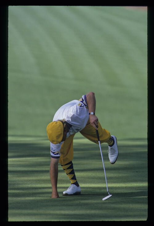 Payne Stewart retrieving the ball from the hole during the 1993 Masters