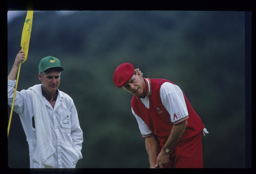 Payne Stewart and his caddie looking over a putt during the 1993 Masters