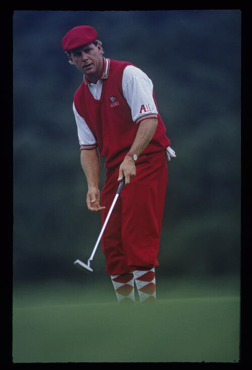 Payne Stewart, with one hand off the putter, urging a putt to drop during the 1993 Masters