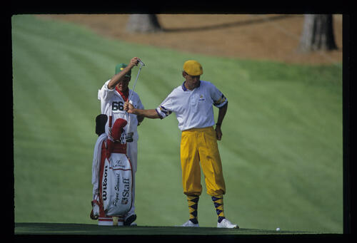Payne Stewart and his caddie decide on putter from the fringe during the 1993 Masters