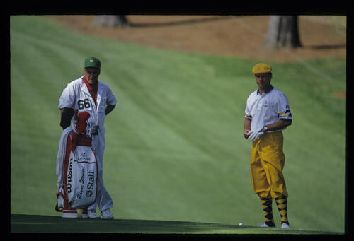 Payne Stewart and his caddie considering a shot from the fringe during the 1993 Masters