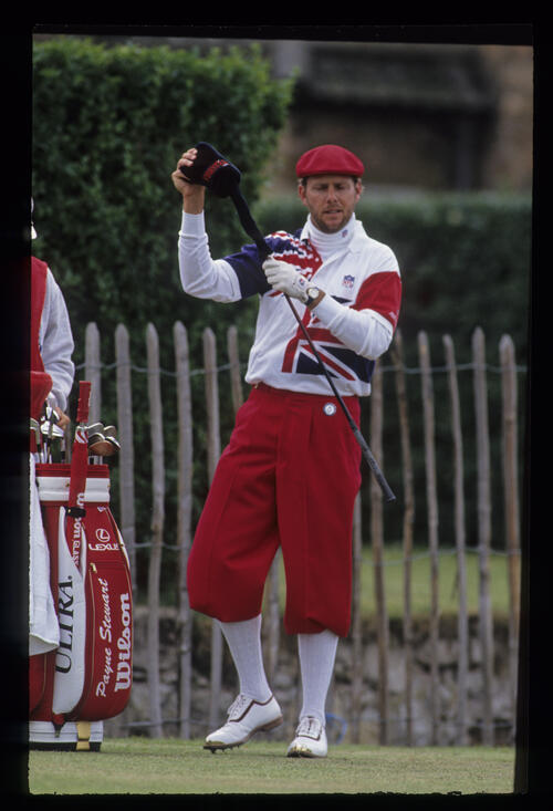 Payne Stewart, well wrapped up, selecting driver on the tee during the 1992 Open Championship