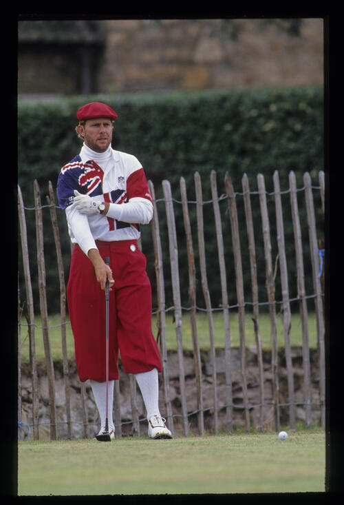 Payne Stewart, well wrapped up, preparing to hit driver on the tee during the 1992 Open Championship