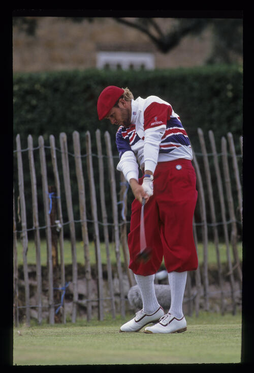 Payne Stewart, well wrapped up, hitting driver on the tee during the 1992 Open Championship