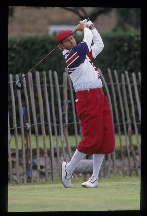 Payne Stewart, well wrapped up, following through after hitting driver on the tee during the 1992 Open Championship