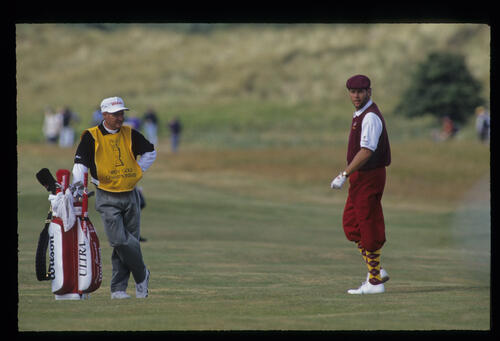 A bearded Payne Stewart and his caddie consider a fairway shot during the 1992 Open Championship