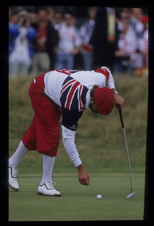 A bearded Payne Stewart marking his ball on the green during the 1992 Open Championship