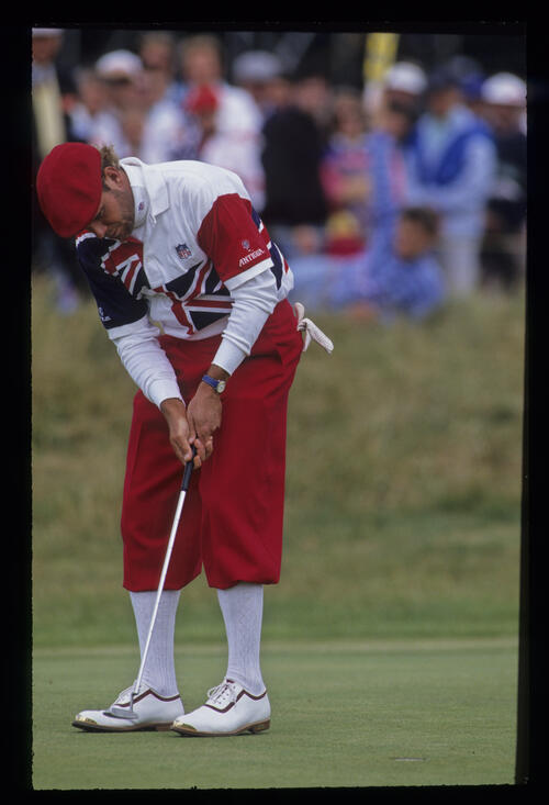A bearded Payne Stewart holing a short putt during the 1992 Open Championship