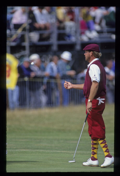 A bearded Payne Stewart tossing the ball to his caddie during the 1992 Open Championship