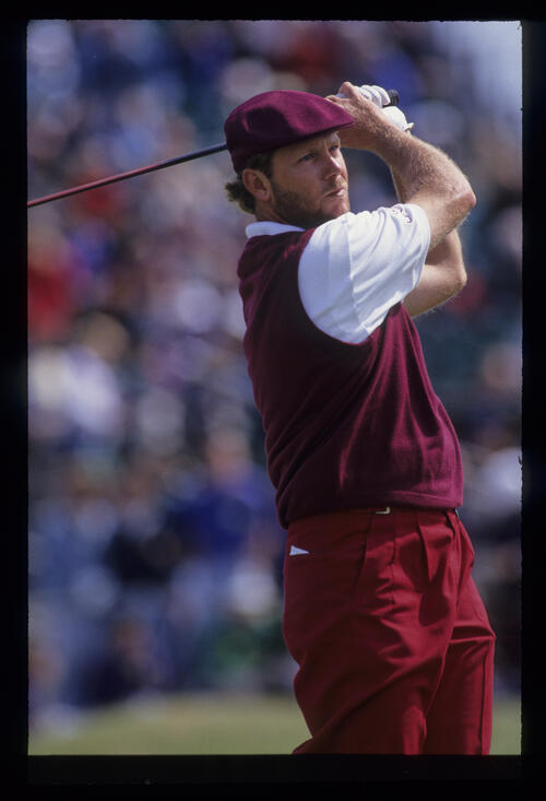 A bearded Payne Stewart following through after hitting driver during the 1992 Open Championship