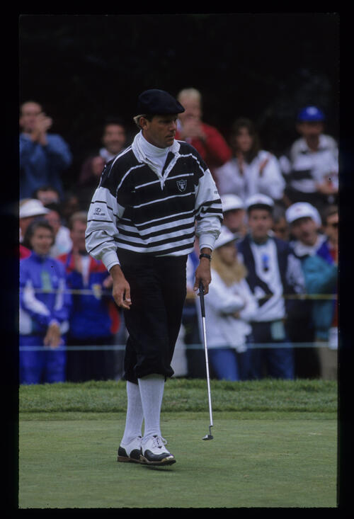 Payne Stewart walking after a putt during the 1992 US Open