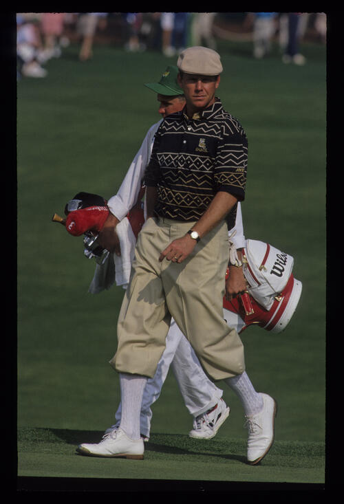 Payne Stewart and his caddie walking onto the green during the 1992 Masters