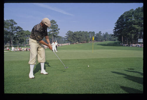 Payne Stewart with a huge breaking putt from the fringe during the 1992 Masters