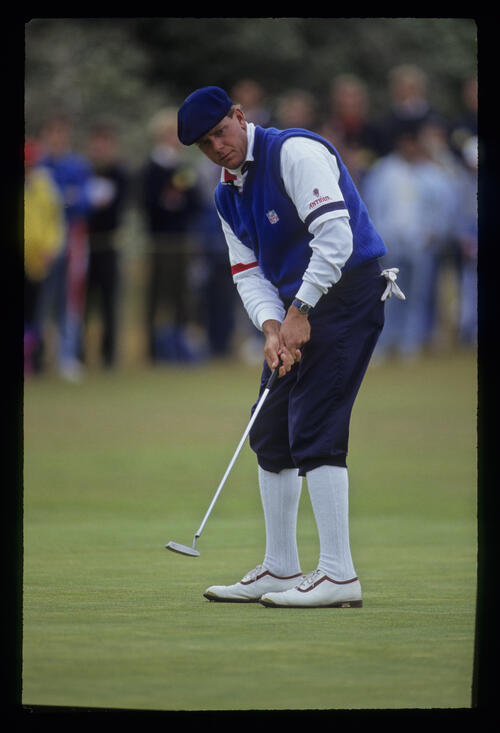 Payne Stewart sending a putt on its way during the 1991 Open Championship