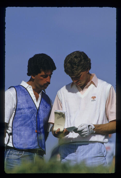 Bob Tway and his caddie checking yardages during the 1987 Phoenix Open
