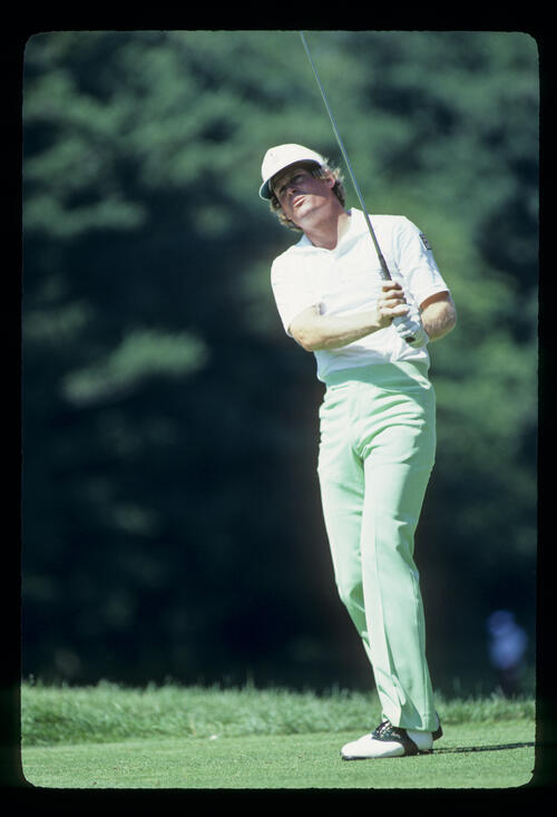 Johnny Miller watching closely after driving during the 1981 US Open