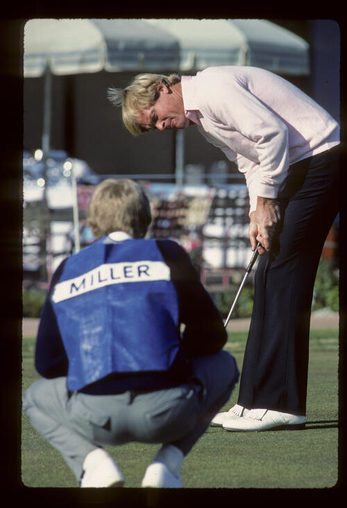 Johnny Miller and his caddie practicing putting during the 1984 Phoenix Open