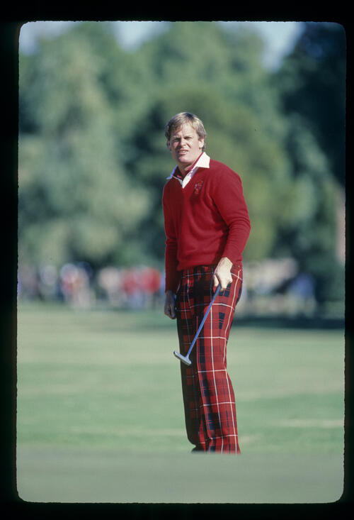 Johnny Miller watching a long putt closely during the 1982 Phoenix Open