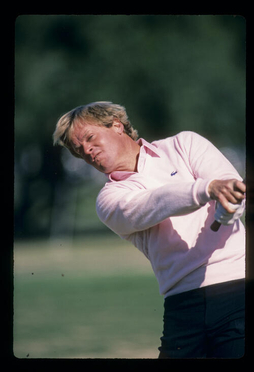 Johnny Miller watching his pitch shot closely during the 1984 Phoenix Open