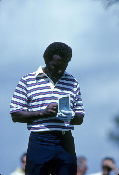 Calvin Peete marking his scorecard during the 1982 Doral Eastern Open