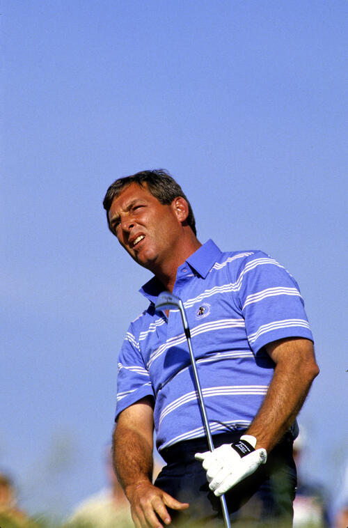 Fuzzy Zoeller watching his long iron shot closely during the 1987 Phoenix Open
