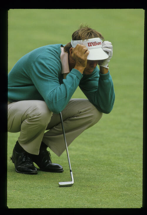 Dale Douglass lining up a putt during the 1987 US Open