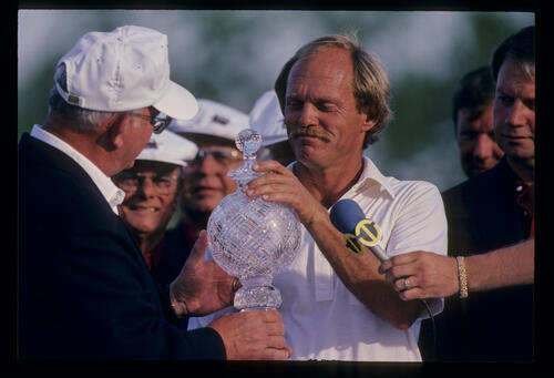 Bob Eastwood receiving the trophy after winning the 1984 USF&G Classic