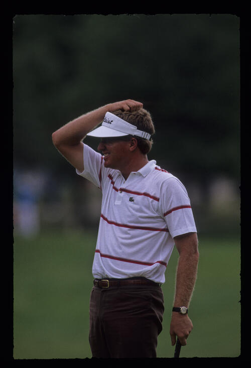Steve Elkington scratching his head on the green during the 1989 US Open