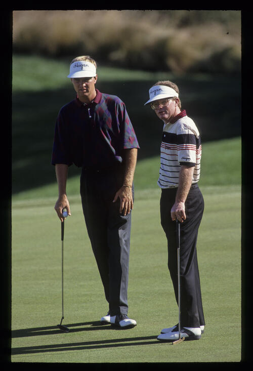 Davis Love III and Tom Kite discussing tactics on the green during the 1991 Shark Shootout