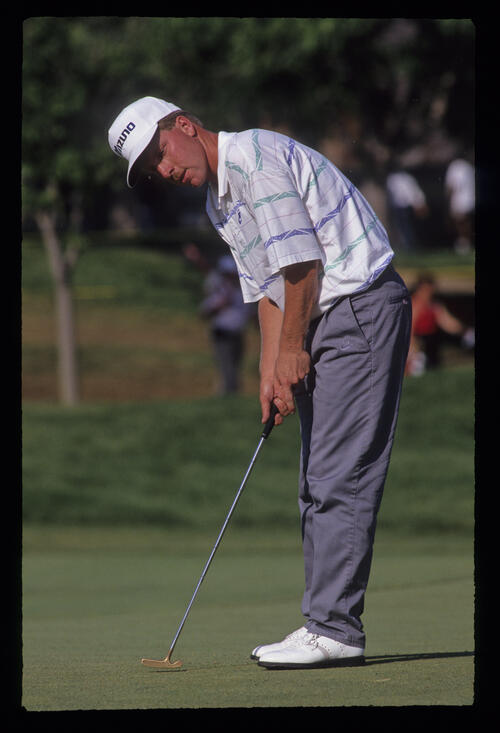 Rick Fehr putting during the 1991 US Open