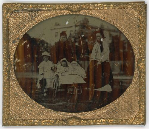 Bruce family, group of women and children with child carriage
