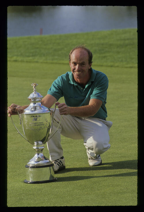 David Gilford smiling with the trophy after winning the 1991 NM English Open