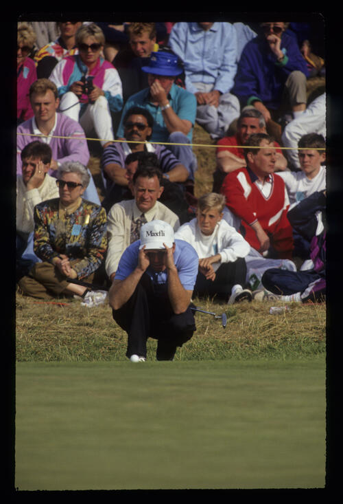 David Gilford shielding his eyes as he lines up a putt during the 1991 Open Championship
