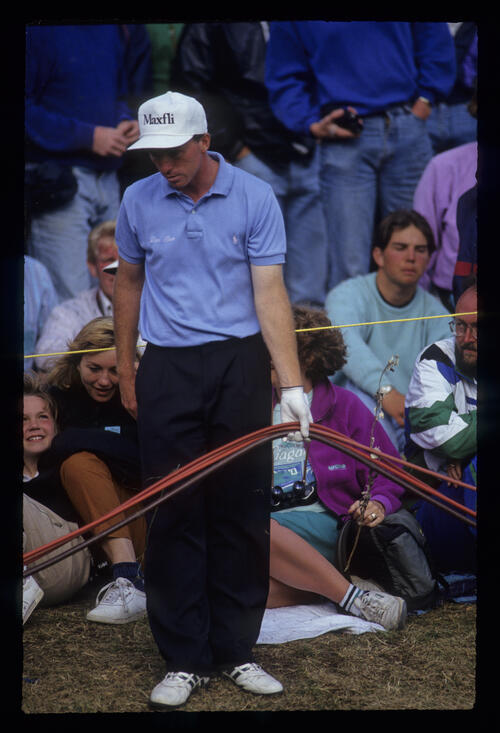 David Gilford finding his approach shot among the crowd and the TV cables during the 1991 Open Championship