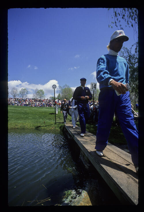 Bill Glasson and Payne Stewart crossing a bridge during the 1989 Memorial Tournament