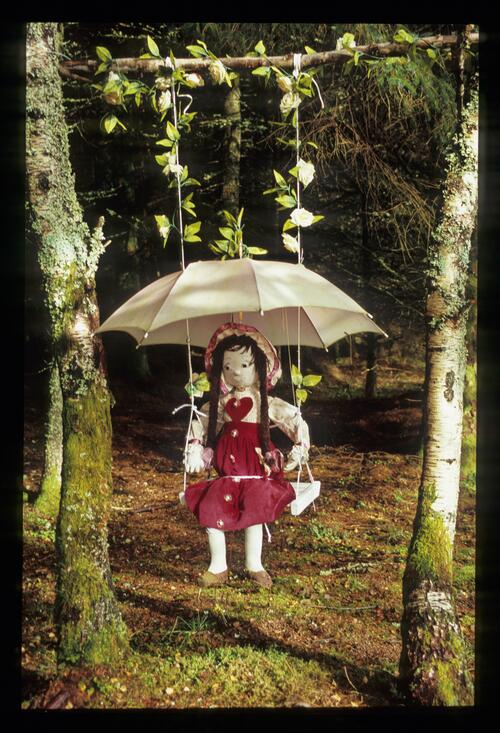 Girl on a swing, the Fairy Forest [Fort William] The Great Glen.