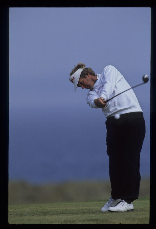 Wayne Grady staying down through the ball on the tee during the 1992 Open Championship