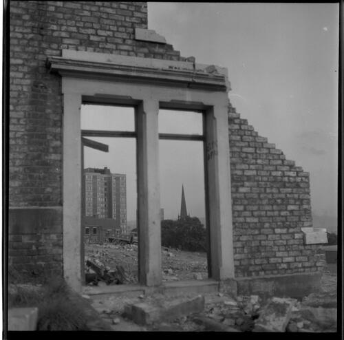 [Building seen through ruined wall and window, Rye Hill]