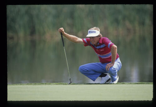 Wayne Grady squatting to line up a putt during the 1989 USPGA