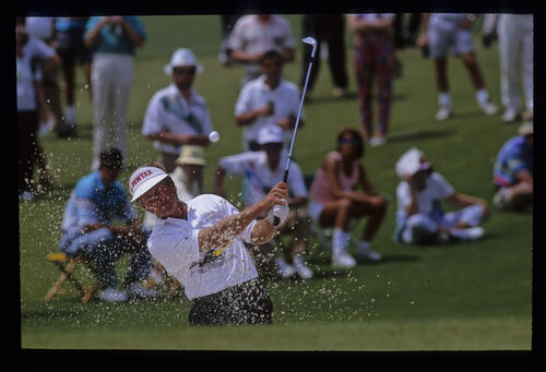Wayne Grady splashing from a bunker during the 1992 Masters