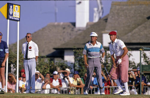 Payne Stewart and Wayne Grady watching the former's drive during the 1989 Open Championship