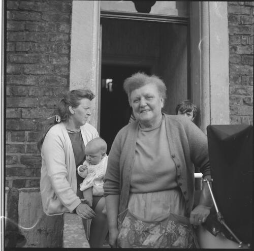[Two unidentified women in front of a doorway, one holding a baby, Rye Hill]